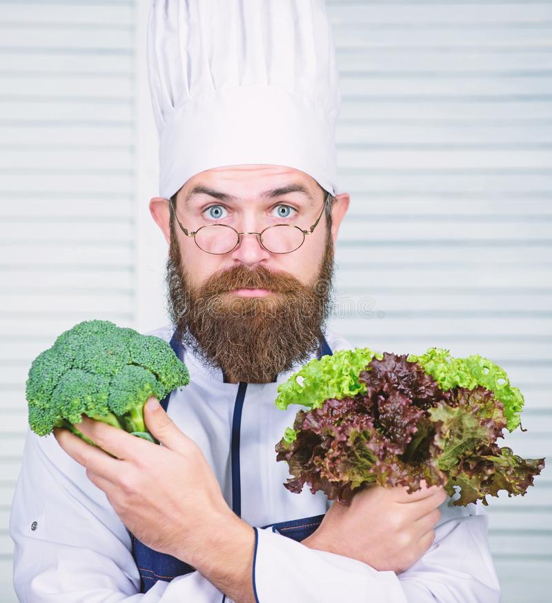Organic vegetables. Healthy nutrition concept. Bearded professional chef cooking healthy food. Healthy vegetarian recipe. I choose only healthy ingredients royalty free stock photography