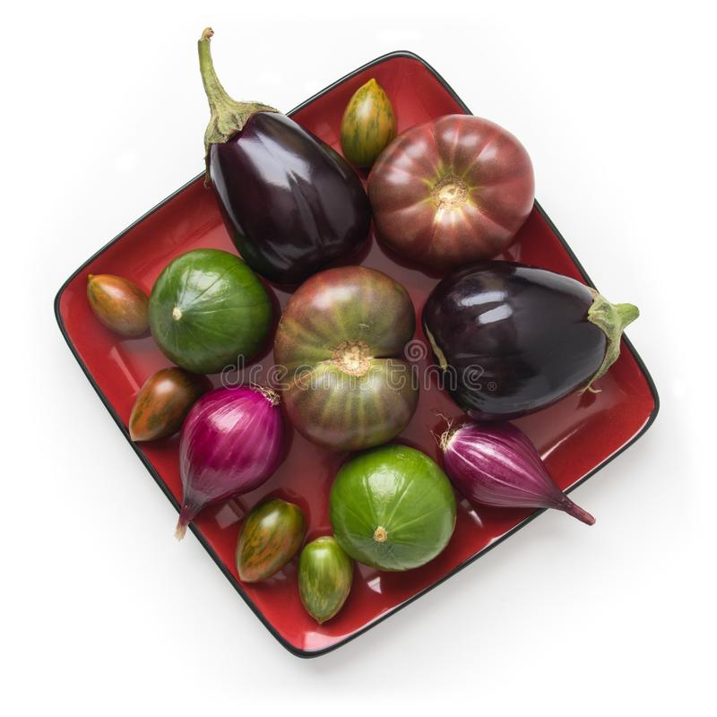 Organic vegetables on a plate stock photography