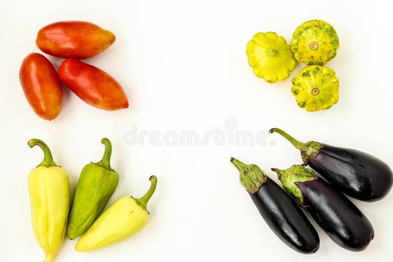 Organic Vegetables: tomatoes, patissons, peppers and eggplant on white background, Organic food concept, horizontal orientation. Copy space royalty free stock photos