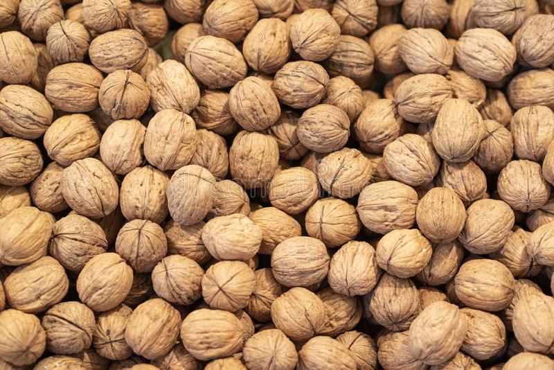 Organic walnuts are sold in the market royalty free stock images