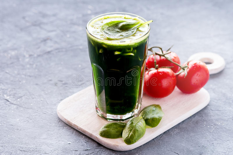 Organic Wheat Grass Spinach and sprout detox drink. Green Organic Wheat Grass Shot ready to drink Healthy and diet drink Vegetables smoothie stock photo