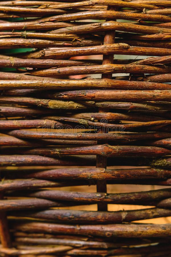 Organic woven willow wicker fence panel suitable for crafts, picnic or gardening background stock images