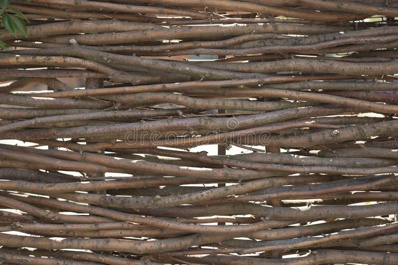 Organic woven willow wicker fence panel suitable for crafts, picnic or gardening background. royalty free stock photos