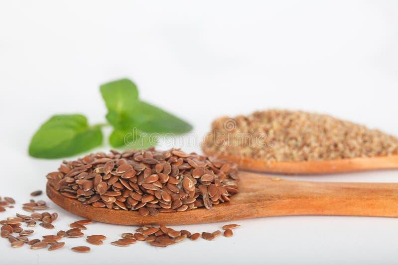 Organicznie linseeds i zmieloni flaxseeds obraz royalty free
