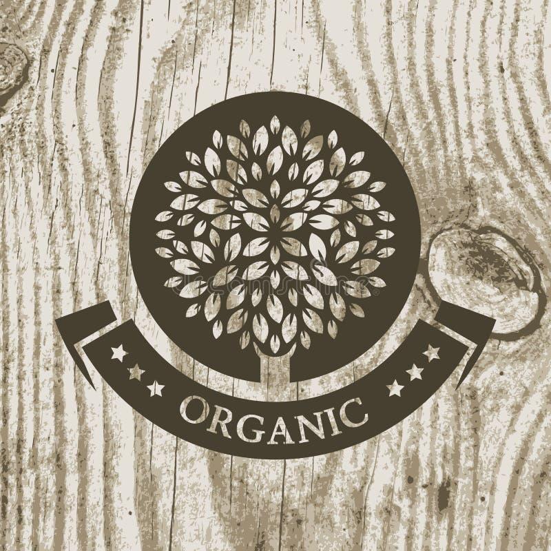 Organicznie produkt odznaka z drzewem na drewnianej teksturze Wektorowy Illust royalty ilustracja
