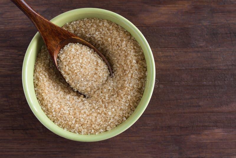 Organisch Cane Sugar in groene kom royalty-vrije stock foto's
