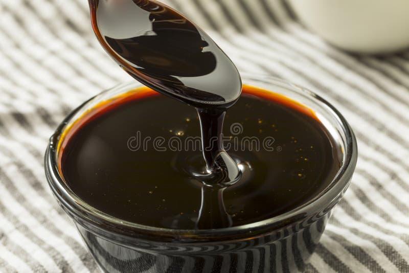 Organisch Zwart Cane Sugar Molasses royalty-vrije stock fotografie