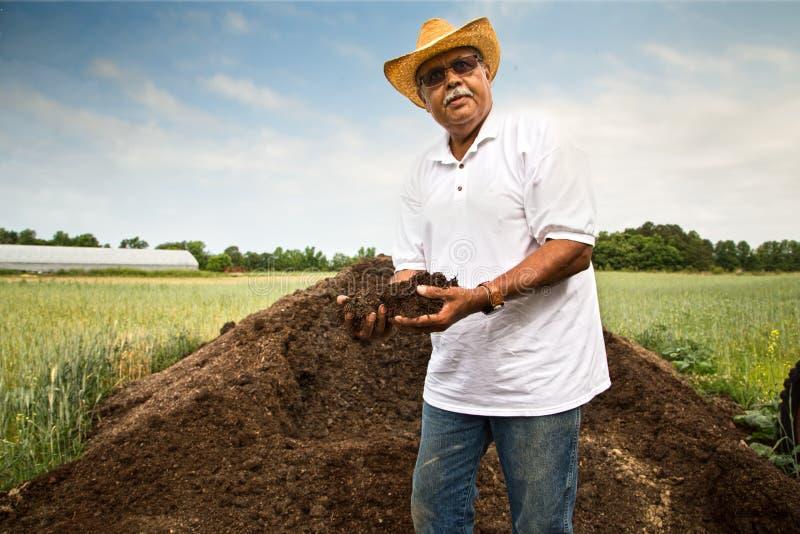Organische Landbouwer stock afbeeldingen