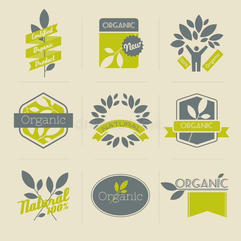 Organische retro etiketten en kentekens met bladeren stock illustratie
