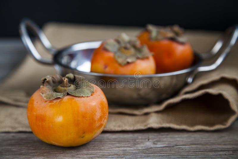 Organiska persimmons fotografering för bildbyråer