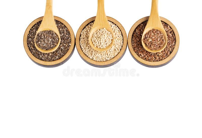 Organiskt frö av quinoaen, Flaxseed och Chia - Superfoods royaltyfri foto