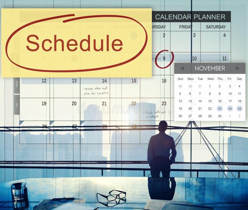 A organização do planejador do calendário da programação lembra o conceito fotos de stock