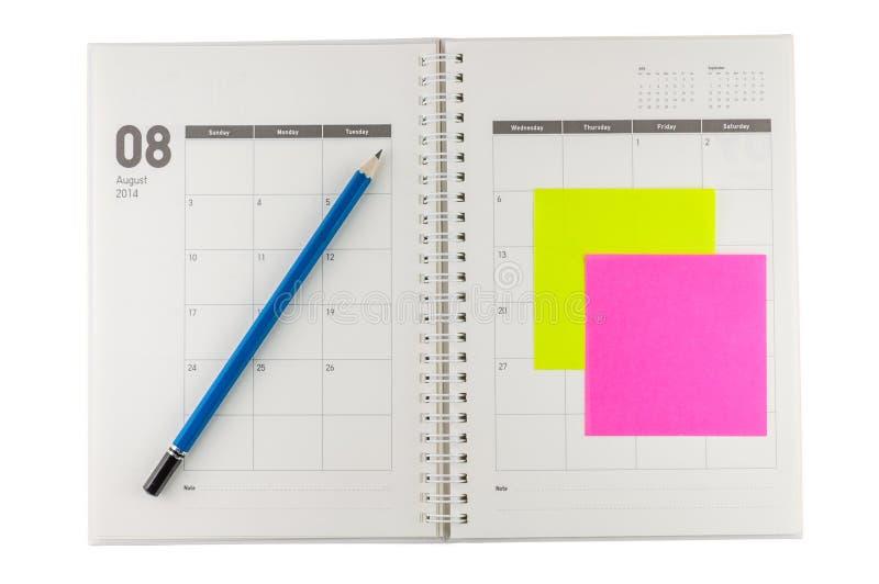 Organizador 2014 de agosto com lápis e post-it foto de stock