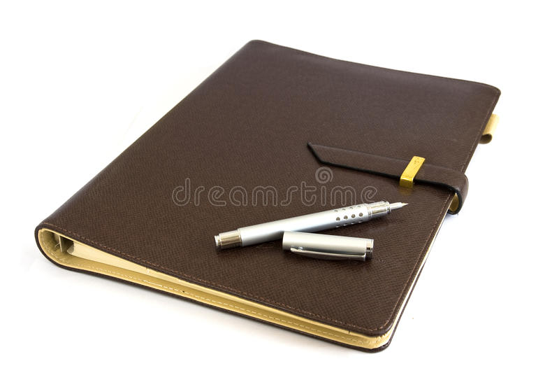 Organizador del asunto con la pluma de plata foto de archivo