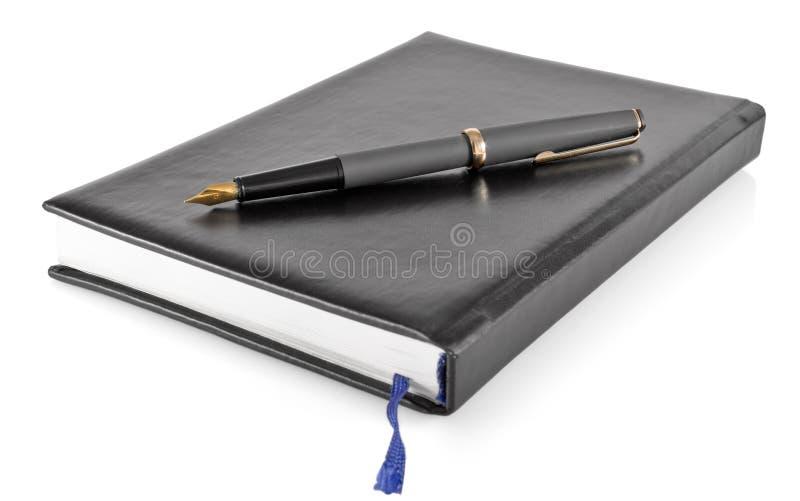 Organizador personal con la pluma de la tinta fotografía de archivo