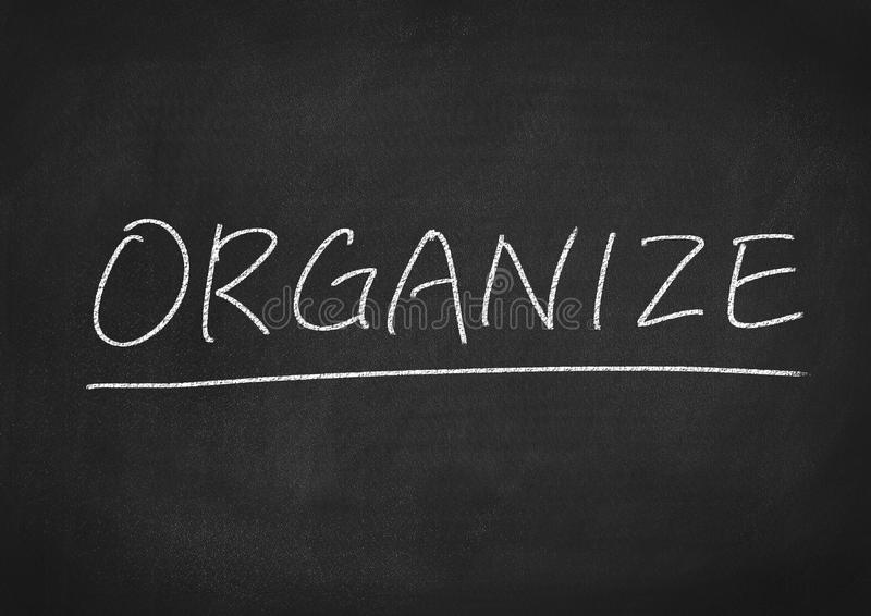 Organize. Concept word on a blackboard background royalty free stock images