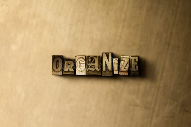 ORGANIZE - o close-up vintage sujo da palavra typeset no contexto do metal ilustração royalty free