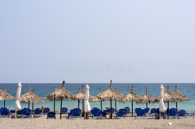 Download Organized Beach With Straw Umbrellas Stock Image - Image: 1171641