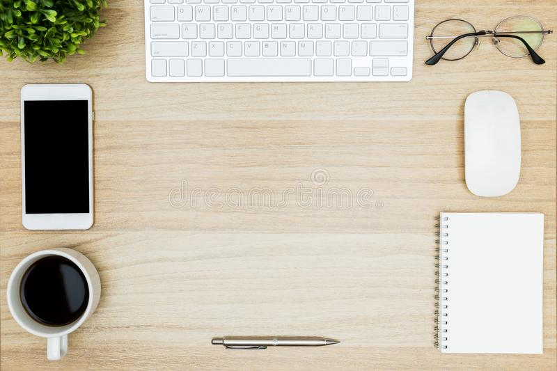 Organized and clean wood desk table with a lot of things on it. Top view with copy space, flat lay royalty free stock photo