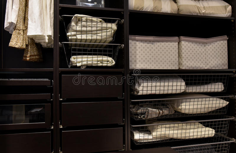 Organized closet wardrobe. Detail of a modern built-in closet wardrobe with things, lower shelves, inside view stock image