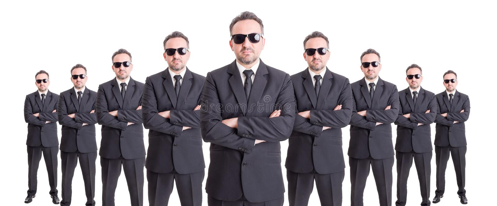Organized group of business people. Standing with confidence on wide image royalty free stock image