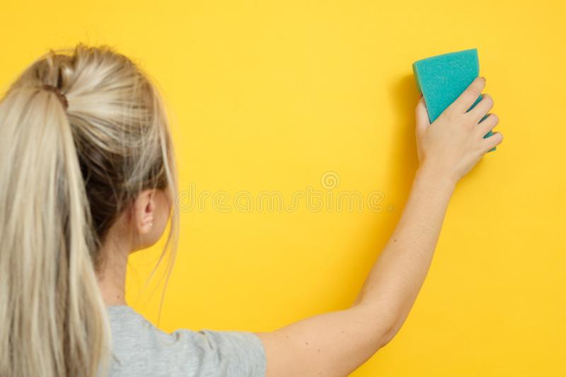 Home cleanup spotless cleaning woman sponge wipe royalty free stock photo