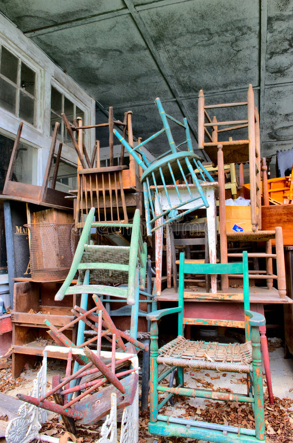 Organized Junk. Vertical photo of large collection of old chairs and furniture stock photography