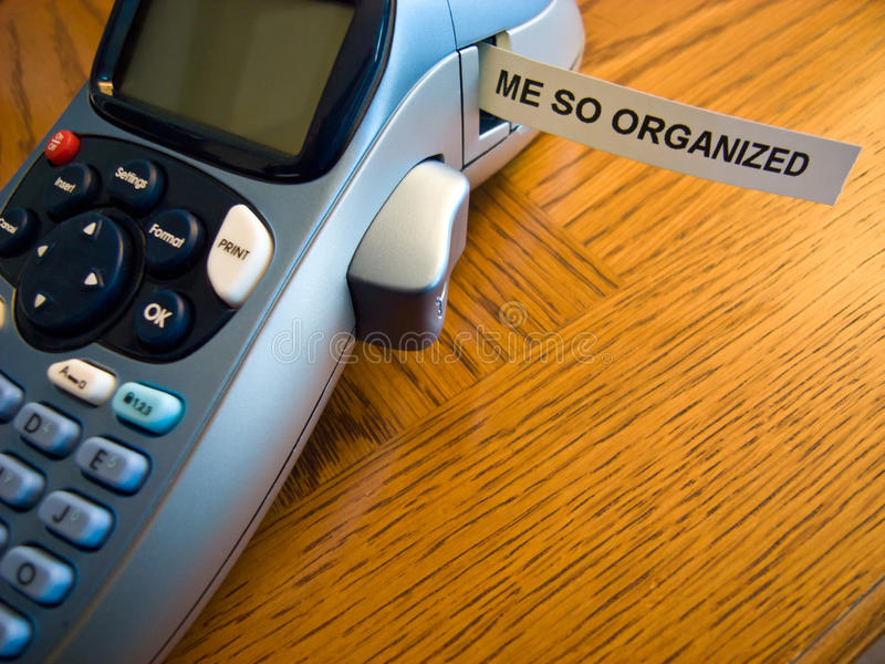 Organized label print. A label printer with a 'me so organized' label that has just been printed stock photo