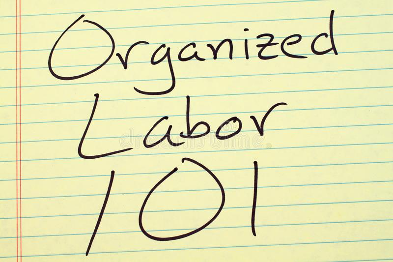 Organized Labor 101 On A Yellow Legal Pad. The words `Organized Labor 101` on a yellow legal pad stock photos