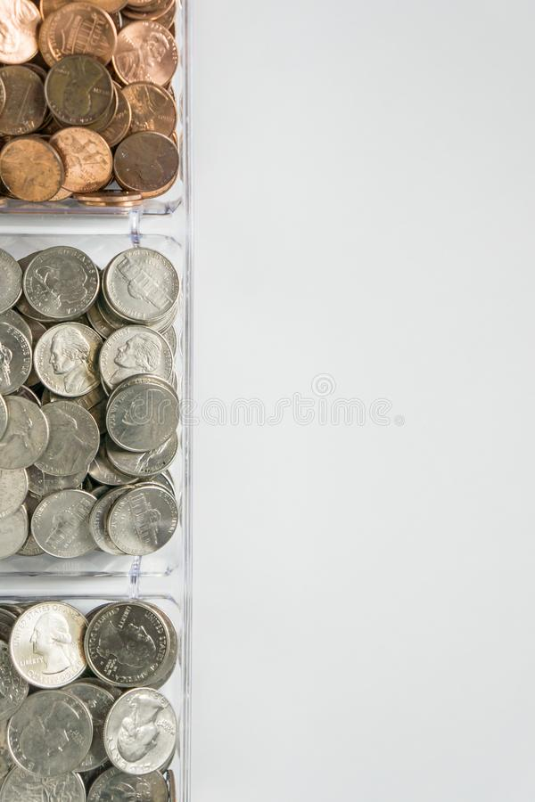 Organized loose coin change on left side, blank empty room space for text right. Isolated organized loose coin change on left side, white background, blank empty stock photos