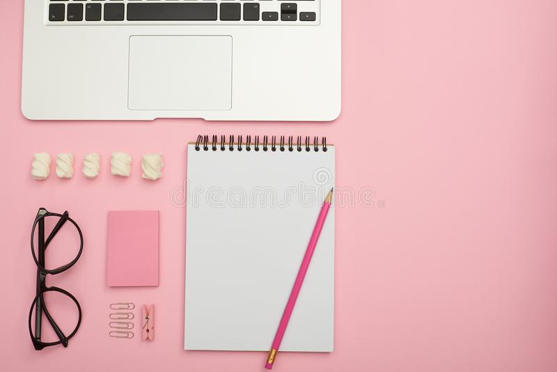 Organized stationery objects in shades of pink. Top view of workplace with organized stationery objects in shades of pink royalty free stock image