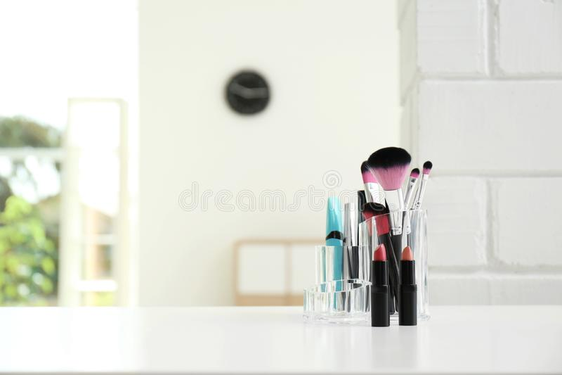 Organizer with makeup cosmetic products on table indoors royalty free stock photos