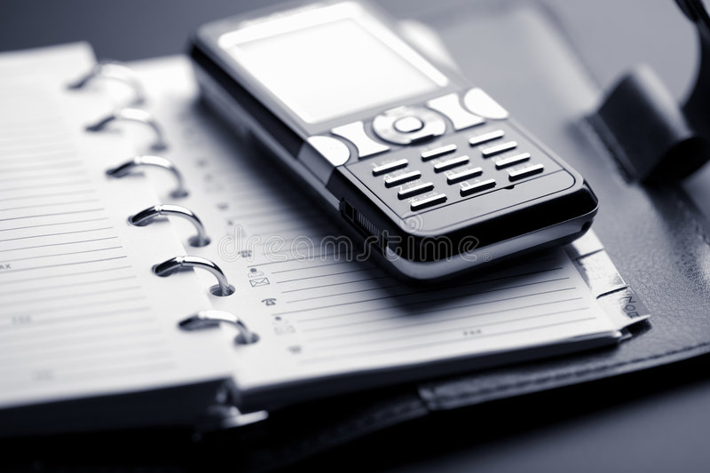 Organizer and mobile phone stock photography