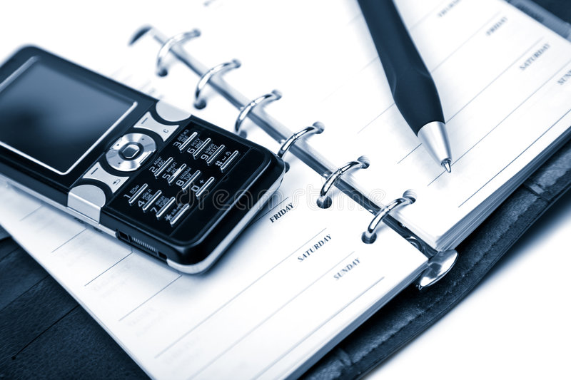 Organizer and mobile phone isolated stock image