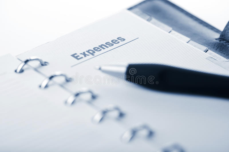 Organizer and pen. expenses page royalty free stock images