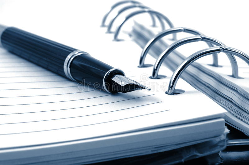 Organizzatore e penna di affari fotografie stock libere da diritti