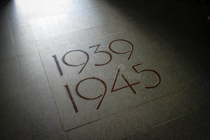 Orglandes,Normandy, France; 4 June 2014: Orglandes Cemetery. tile on the cemetery floor of Orglandes indicating the years 1939 to. 1945, the duration of the royalty free stock photography