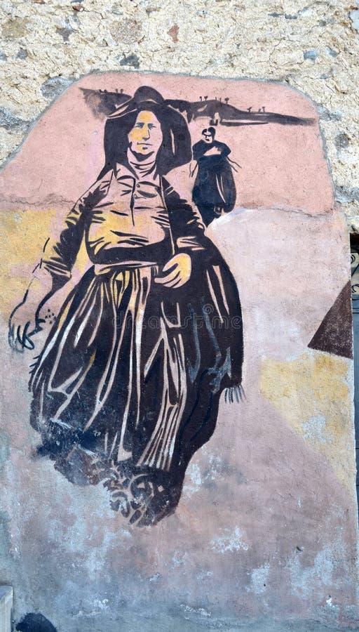 ORGOSOLO ITALIEN am 4. Oktober 2015 Murales in Orgosolo Italien, da ungefähr 1969 die Wandbilder verschiedene Aspekte von Sardini lizenzfreie stockbilder