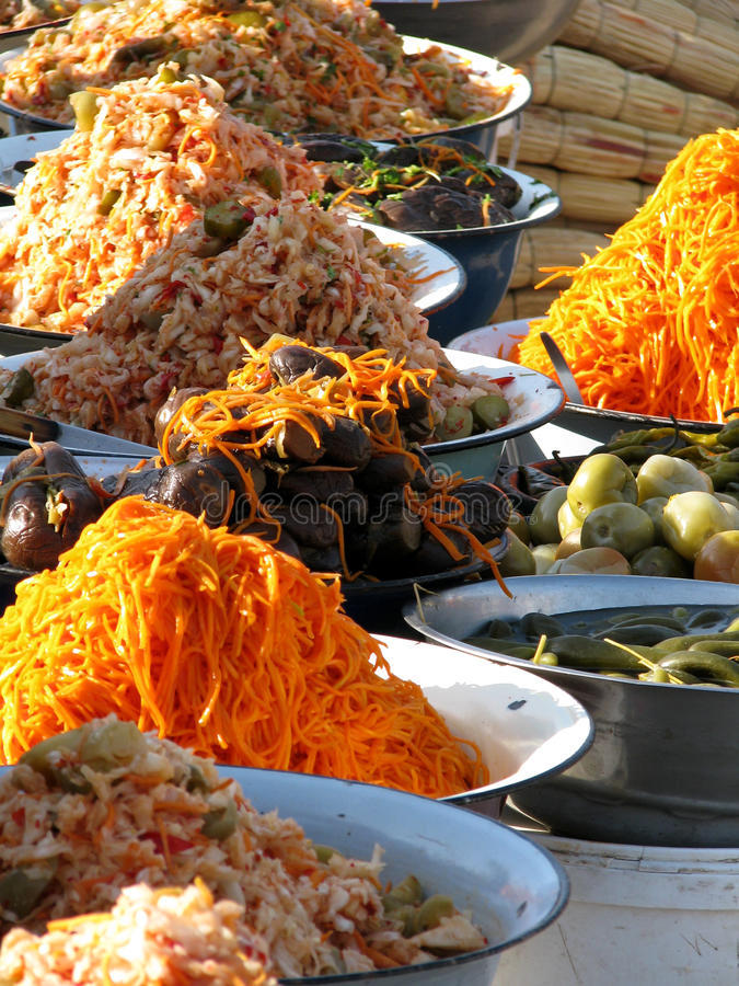 Oriental bazaar foods - corean marinades. Corean marinades (carrots, aubergines, tomatos, sauerkraut, capsicum). Traditional foods at the biggest oriental bazaar stock image