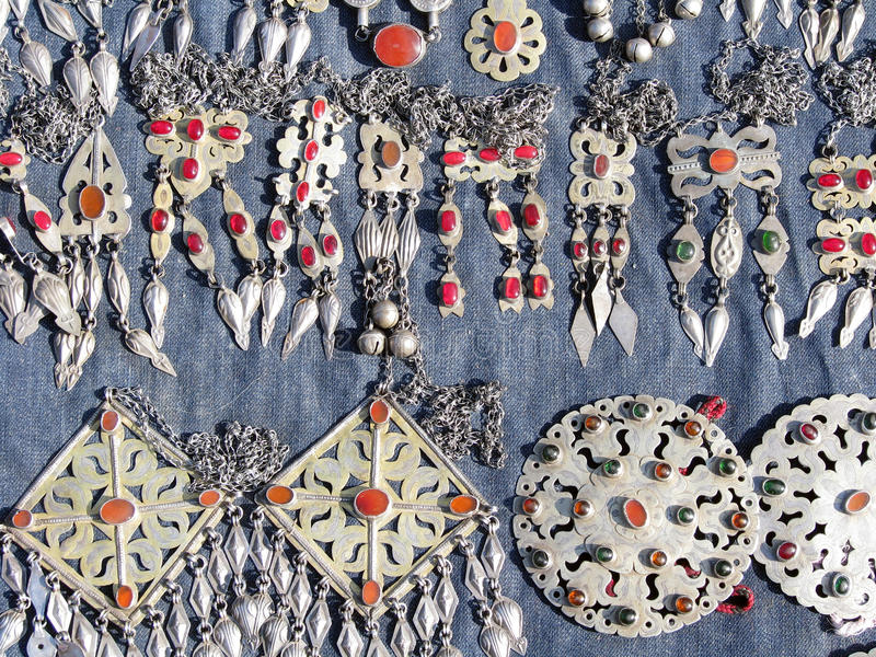 Oriental bazaar objects - jewelry. Jewelry. Traditional objects at the biggest oriental bazaar in turkmenistan tolkuchka close to ashgabat, - one of the main stock photography