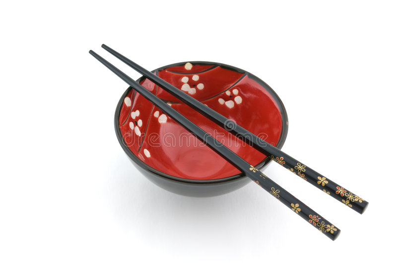 Oriental bowl and chopsticks royalty free stock image