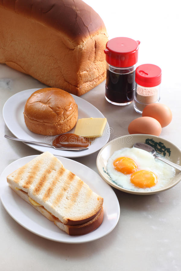 Oriental breakfast. Traditional oriental breakfast with bread and half-boiled eggs royalty free stock image