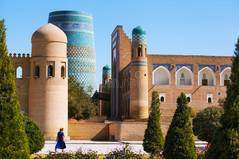Oriental buildings in the city. Oriental buildings with trees in the city of Itchan Kala. Khiva, Uzbekistan royalty free stock image