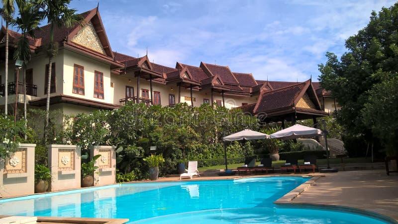 Oriental buildings in a Khao Yai resort, Thailand. Scenic view of Oriental buildings and swimming pool from the Phuwanalee resort in Khao Yai, Thailand royalty free stock images