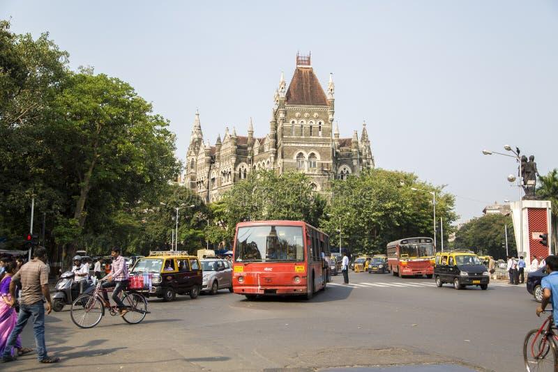 Oriental buildings in Mumbai, India. MUMBAI, INDIA - OCTOBER 9, 2015: Unidentified people by the Oriental buildings in Mumbai, India. Building was built at 18850 royalty free stock photo