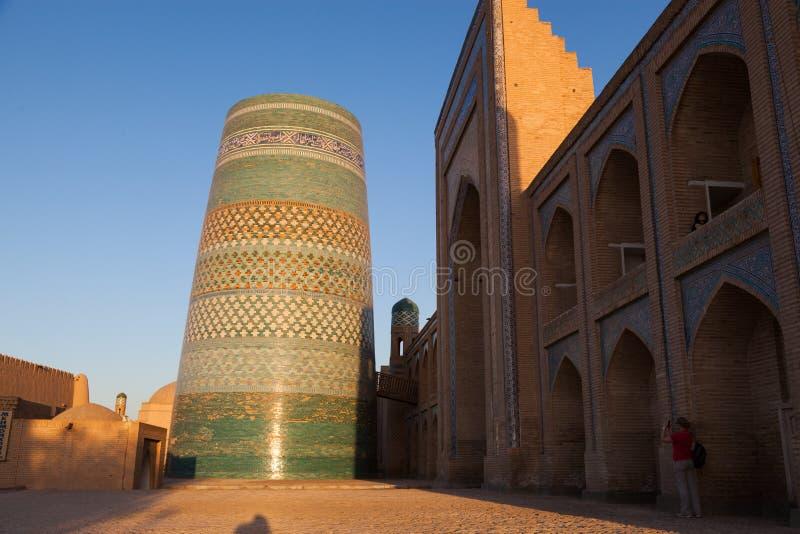 Kalta Minor minaret in Khiva, Khorezm Region, Uzbekistan. Oriental buildings of old city of Itchan Kala. Khiva, Uzbekistan royalty free stock image