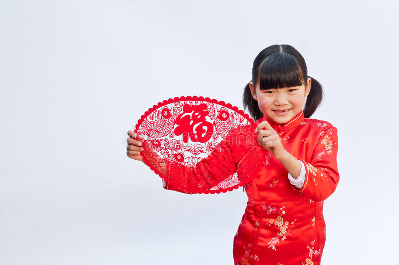 Happy New Year. Oriental children holding a paper-cut happy New Year stock photo