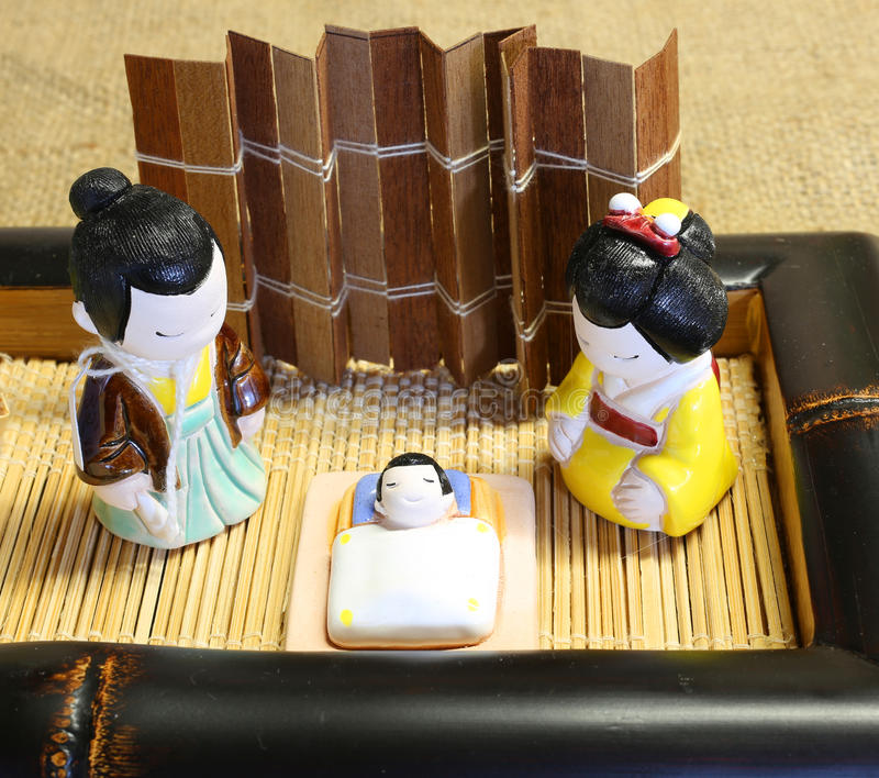 Oriental crib with the holy family in porcelain royalty free stock photography