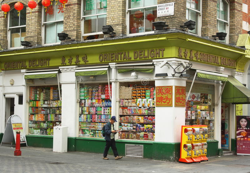 Oriental Delight Grocery Store. London, England - Sept 4th, 2014: A man walks by the Oriental Delight supermarket in Macclesfield Street in London's Chinatown stock photo