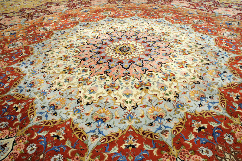 Oriental handmade carpet. Beautiful oriental handmade carpet in Sheikh Zayed Mosque, Abu Dhabi United Arab Emirates royalty free stock photography